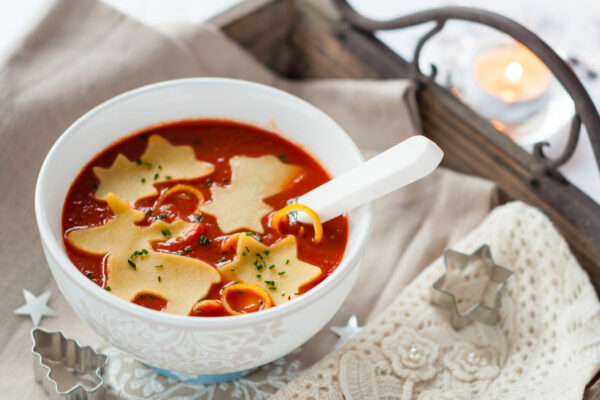 Bowl of Homemade Tomato Soup with Fresh Pasta. Winter Decoration.
